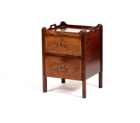 A George III mahogany and later commode
