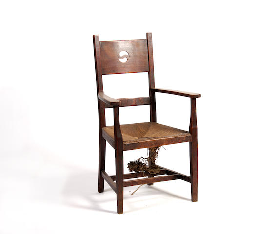 An oak Arts and Crafts armchair in the manner of George Walton