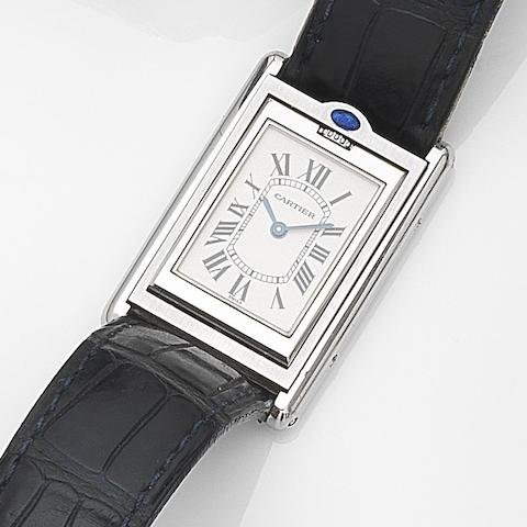 Cartier. A stainless steel quartz reversible wristwatch with box and papers Tank Basculante, Ref:W1011258, Case No.240520425CD, Sold 11th January 2001