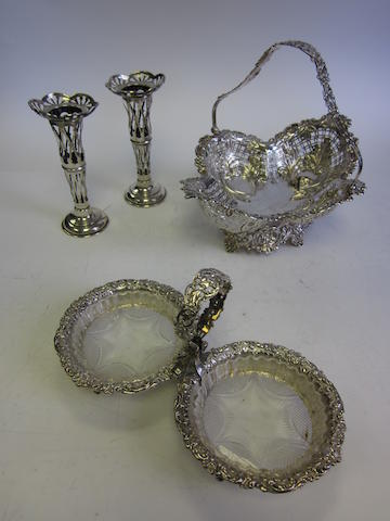 A Victorian silver swing-handled basket by James Dixon & Son, Sheffield 1898 together with a pair of silver flower vases, Birmingham 1906 and a twin compartment bonbon dish, by James Dixon & Son, Sheffield 1897 (4)