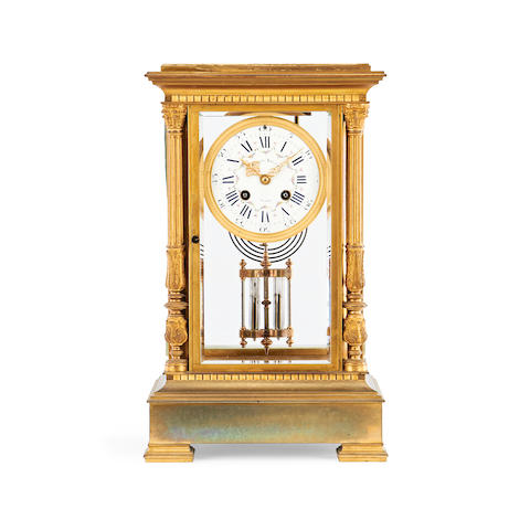 A 19th century gilt metal four glass mantel clock by Hubert Krietz, Anvers