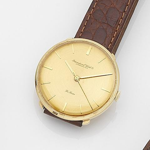 IWC. An 18ct gold manual wind centre seconds wristwatchDe Luxe, Case No.1439835, Movement No.1404866, Circa 1957
