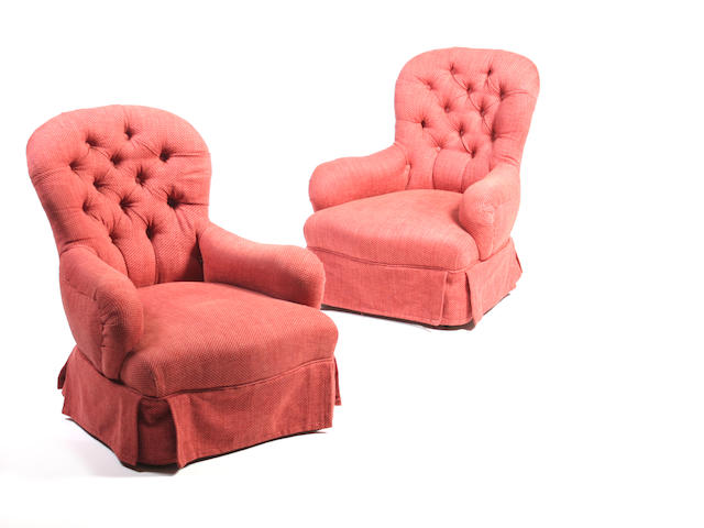 A pair of Victorian button back armchairs