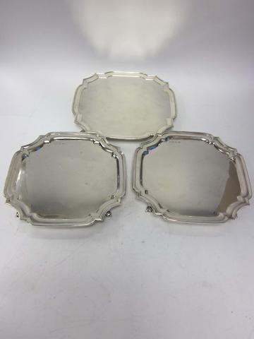 A pair of silver salvers by E Viner, Sheffield 1944, together with a larger shaped-square silver salver, by Barnard & Sons Ltd, London 1926 (3)