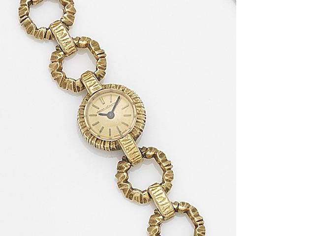 Jaeger-LeCoultre. A lady's 18ct gold manual wind bracelet watch Case No.1121523, Movement No.1083372, Circa 1955