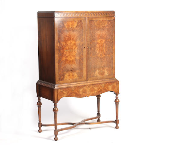 A burr walnut cabinet on stand second quarter 20th century