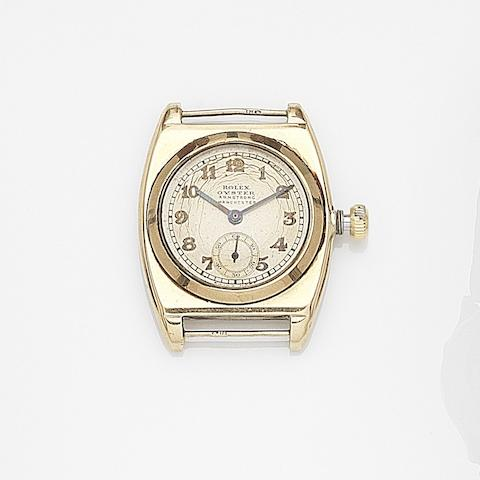 Rolex. A 9ct gold manual wind watch head Oyster, Case No.30310, Retailed by Armstrong, Manchester Circa 1933