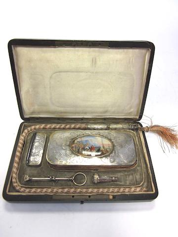 A mid-19th century cased French parcel-gilt lady's smoking compendium by Bruneau, Paris circa 1840