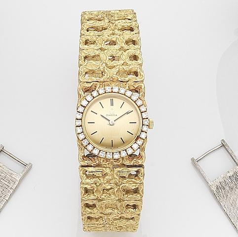 Omega. A lady's 18ct gold and diamond set manual wind bracelet watchRef:7168, Case No.909287, Movement No.22840426, Circa 1965