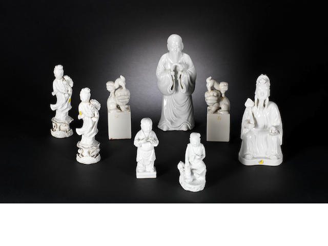 Eight white-glazed figures