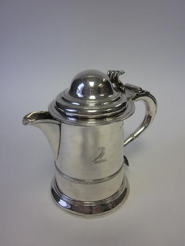 A silver tankard with later added pouring lip with cancelled marks and stamped with London Assay Office incuse mark and case number, LAO 8933