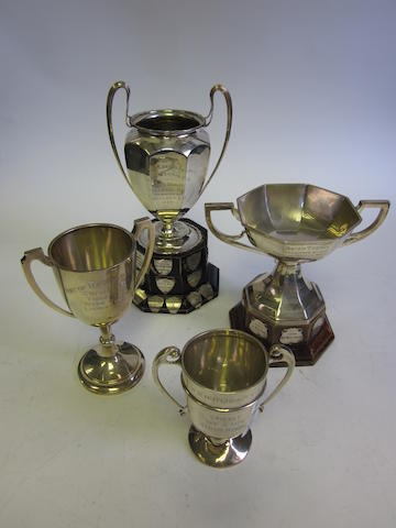 Four varying silver two-handled presentation cups  (4)