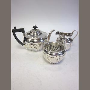 A matched silver three-piece tea service teapot by G M Jackson, London 1893,  sugar bowl and cream jug, by Thomas Hayes, Birmingham 1871 and other silver items (Qty)