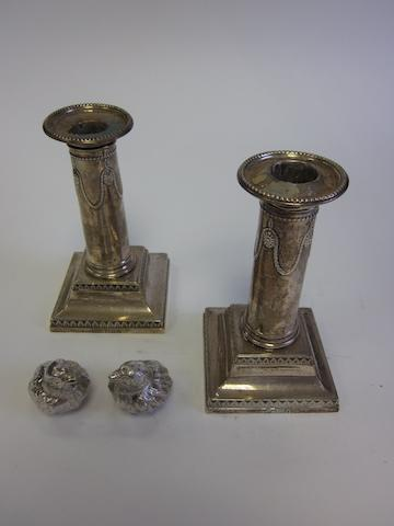 A pair of  silver novelty salt and pepper shakers  by Samuel Mordan & Co, Chester 1905; together with a pair of Adam-style candlesticks, by Thomas Bradbury & Son, London 1900/1901  (4)