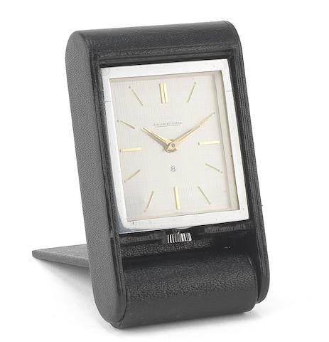 Jaeger-LeCoultre. A chrome plated and calf skin manual wind 8-day travel alarm clockCirca 1950