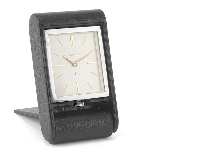 Jaeger-LeCoultre. A chrome plated and calf skin manual wind 8-day travel alarm clock Circa 1950