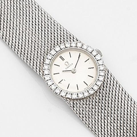 Omega. A lady's 18ct white gold and diamond set manual wind bracelet watchRef:7168, Case No.909134, Movement No.21767393, Circa 1964