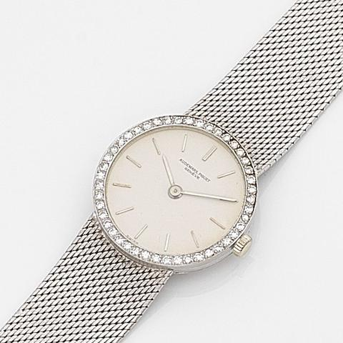 Audemars Piguet. A lady's 18ct white gold and diamond set manual wind bracelet watch Case No.37579, Movement No.92340, Sold 10th November 1966