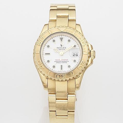 Rolex. A lady's 18ct gold automatic calendar bracelet watch Yacht-Master, Ref:69628, Case No.T799255, Movement No.3539084, Circa 1996