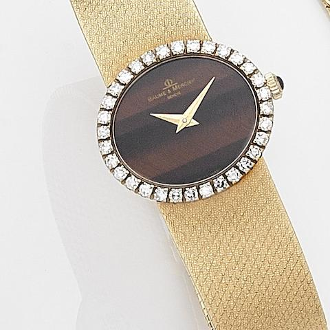 Baume & Mercier. A lady's 18ct gold and diamond set manual wind bracelet watch Ref:38236T2, Case No.597502, Circa 1975