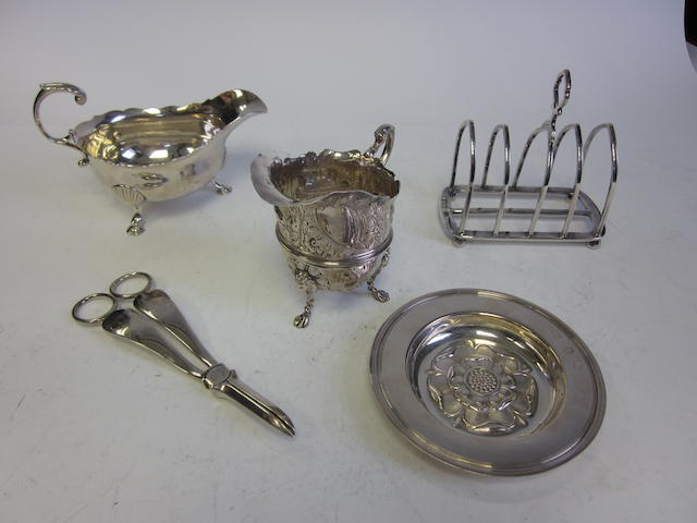 A late George II silver sauceboat by William Robertson, London 1759 and other items (9)