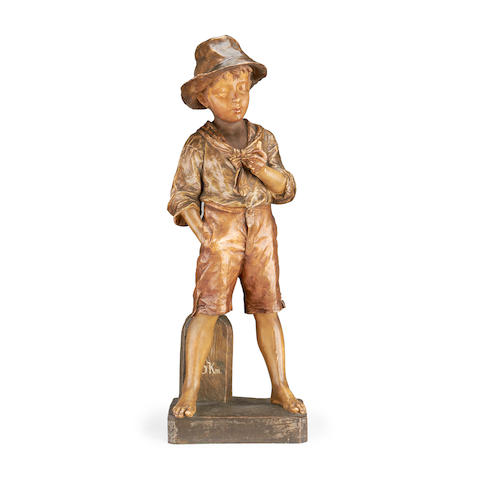 A large early 20th century Goldscheider type figure of a boy