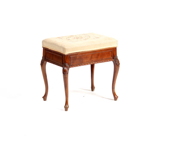 An Edwardian mahogany piano stool