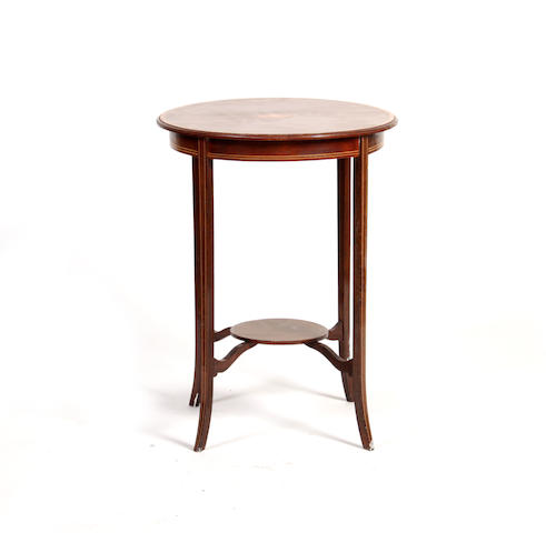 An Edwardian mahogany and satinwood cross-banded circular occasional table