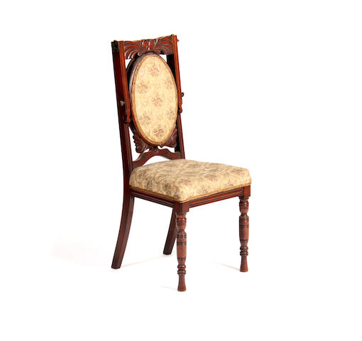An unusual late Victorian carved walnut chair