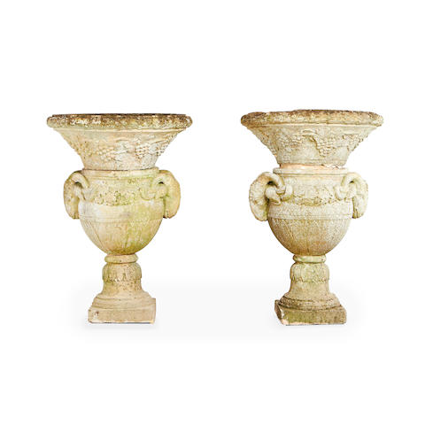 A pair of French 19th century stone garden urns