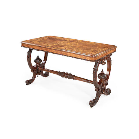 A Victorian carved walnut, sycamore, purplewood and harewood floral marquetry centre table