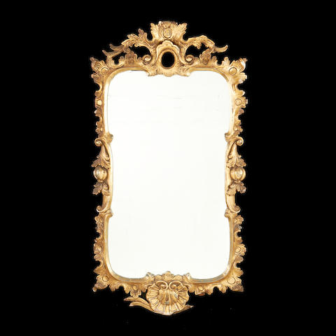 A 19th century giltwood mirror in the George II style