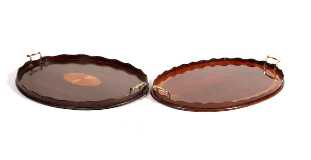 Two Edwardian oval-shaped mahogany trays