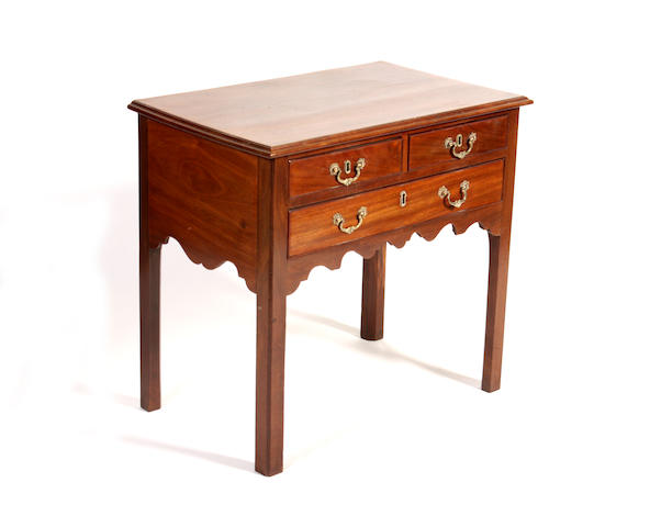 An 18th century style mahogany side table
