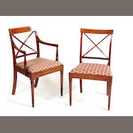 A set of eight late George III mahogany dining chairs