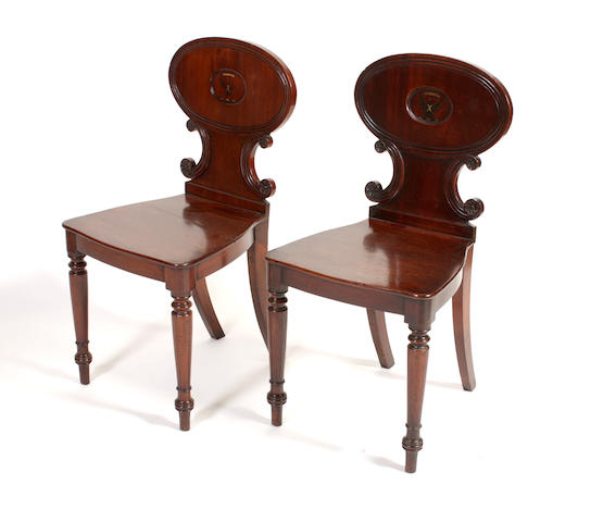A pair of early 19th century hall chairs
