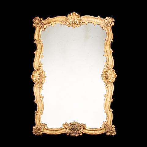 A large late 19th century giltwood overmantel mirror