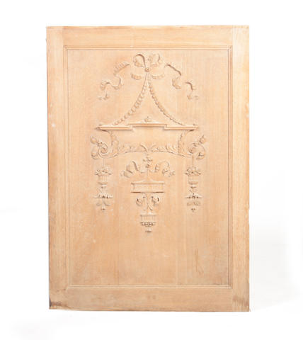 An Edwardian carved oak panel