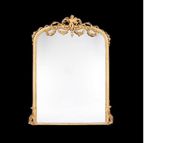 A large late 19th century giltwood and composition overmantel mirror  in the Louis XVI style