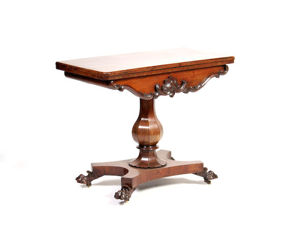 A early Victorian rosewood fold-over card table