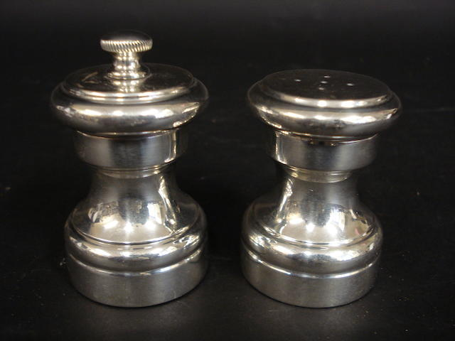 A pair of Cartier sterling silver salt and pepper mills