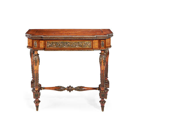 A French 19th century gilt metal mounted amaranth and stained fruitwood marquetry and parquetry card table in the Louis XVI style