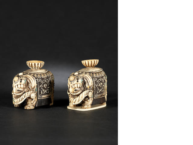 Two small ivory okimono, carved as elephants Meiji Period; one inscribed on the base Masaharu