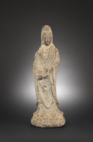 A granite, or other grey stone, figure of Guanyin