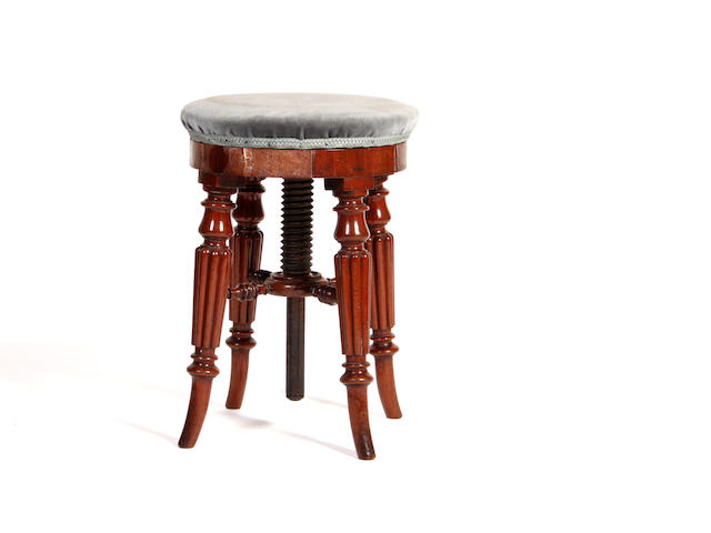 An early Victorian mahogany adjustable circular stool