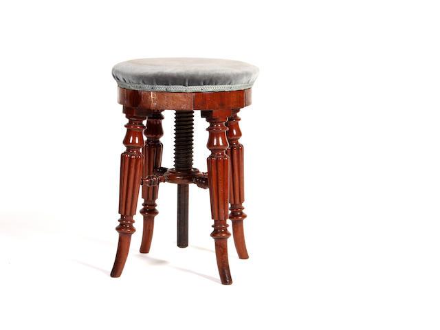 An early Victorian mahogany adjustable circular stool