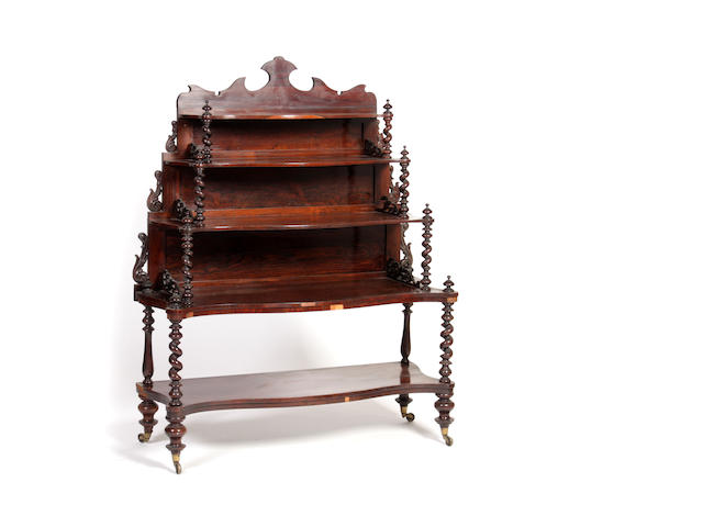 A Victorian rosewood five-tier serpentine front what-not