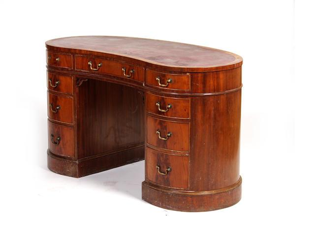A kidney-shaped pedestal deskFirst half twentieth century