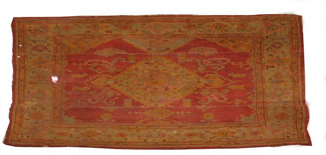 An Ushak carpet 436cm x 397cm