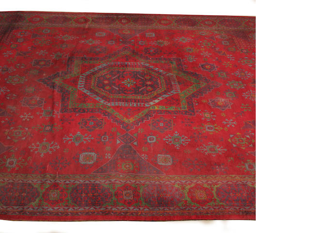 A large Turkey carpet 590cm x 414cm
